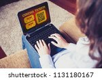 woman using a laptop to buy... | Shutterstock . vector #1131180167