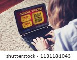 woman using a laptop to buy... | Shutterstock . vector #1131181043