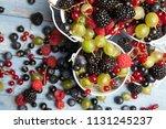 various fresh summer berries.... | Shutterstock . vector #1131245237