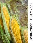 fresh corn on cobs on rustic... | Shutterstock . vector #1131249773