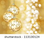 Three beautiful golden christmas balls on a golden background - stock photo