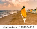 colorful closed sunshades of... | Shutterstock . vector #1131384113