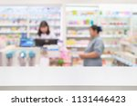 pharmacy counter table with... | Shutterstock . vector #1131446423