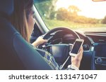 woman traveler using smart... | Shutterstock . vector #1131471047