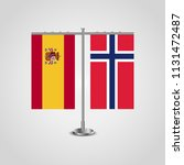 table stand with flags of spain ... | Shutterstock .eps vector #1131472487
