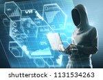 side view on no face hacker in... | Shutterstock . vector #1131534263