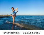 a cheerful dark haired woman... | Shutterstock . vector #1131553457
