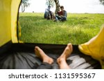 yellow tent camping. glade... | Shutterstock . vector #1131595367
