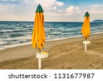 colorful closed sunshades of... | Shutterstock . vector #1131677987