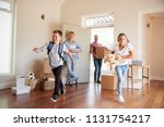 excited family carrying boxes... | Shutterstock . vector #1131754217