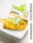 grilled chicken satay in white... | Shutterstock . vector #1131782633