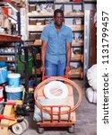african american man carrying... | Shutterstock . vector #1131799457