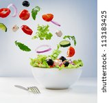 Fresh vegetarian salad on the plate - stock photo