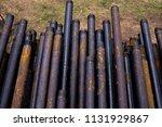 oil drill pipe. rusty drill... | Shutterstock . vector #1131929867