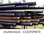 oil drill pipe. rusty drill... | Shutterstock . vector #1131929873