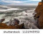 surfer on the pacific ocean at... | Shutterstock . vector #1131945953
