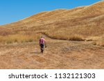 a photographer is carrying a... | Shutterstock . vector #1132121303
