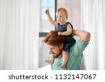 family  fatherhood and people... | Shutterstock . vector #1132147067