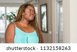 african american woman at home... | Shutterstock . vector #1132158263