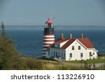 The candy striped west quoddy lighthouse on the atlantic ocean in Northern Maine - stock photo