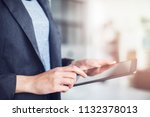 female hands holding a tablet | Shutterstock . vector #1132378013