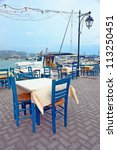 Table in a Greek traditional tavern, Lefkada Greece - stock photo