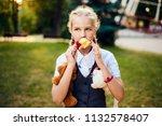 schoolgirl with pigtails in... | Shutterstock . vector #1132578407