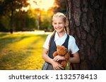 schoolgirl in uniform laughs... | Shutterstock . vector #1132578413
