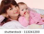 a luck caucasian mom with her... | Shutterstock . vector #113261203