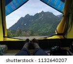 scenic view lying in tent...   Shutterstock . vector #1132640207
