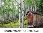An Old  Rundown Outhouse Sits...