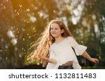 curly girl dancing in flying...   Shutterstock . vector #1132811483