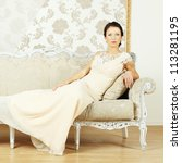 Stylish woman in a evening gown in a luxurious interior - stock photo