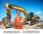 worker with bulldozer in road... | Shutterstock . vector #1132825523