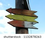 wooden signposts in the form of ... | Shutterstock . vector #1132878263