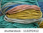 Colorful lobster float ropes sitting on a working lobster fishing dock in Northern Maine - stock photo