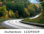 Scenic road through colorful trees in Allegheny national forest - stock photo