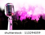 live music background.Vintage microphone and public - stock photo