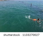 children jumping into the sea...   Shutterstock . vector #1133270027