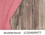 the checkered tablecloth on... | Shutterstock . vector #1133409977