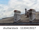two old chimneys the roof of an ... | Shutterstock . vector #1133415017