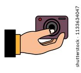 hand user with camera...   Shutterstock .eps vector #1133634047