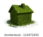 concept ecology house from grass with scissors - stock photo