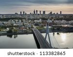 Sundown over Warszawa city, Poland with Vistula river - stock photo