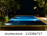the swimming pool at night... | Shutterstock . vector #113386717