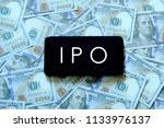 a mobile phone with letter ipo... | Shutterstock . vector #1133976137