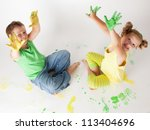 Painting is fun for kids - happy children play with the paint - stock photo