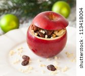 stuffed apple with raisins and nuts - stock photo