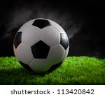 soccer football on green grass studio light - stock photo