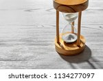 hourglass with flowing sand on... | Shutterstock . vector #1134277097